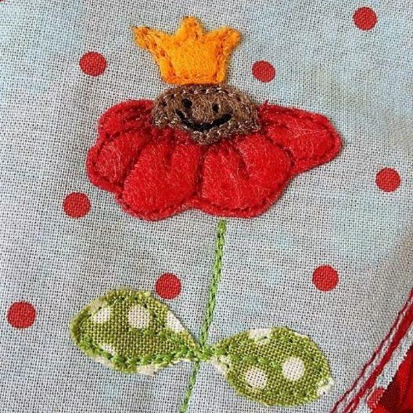 Blume mit Krone applizieren